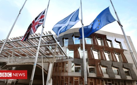 100187398 flags parliament - MSPs call for solution to devolution row 'impasse'