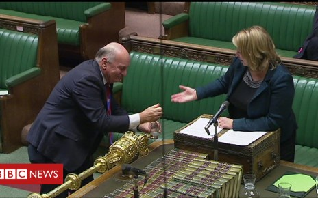 104016551 p06prf29 - Stephen Pound crosses Commons floor to clean up water spillage