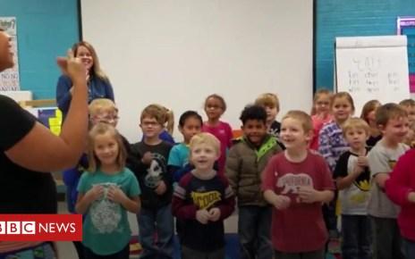 104036621 p06pvydm - Kindergartners' give sign language surprise to school janitor