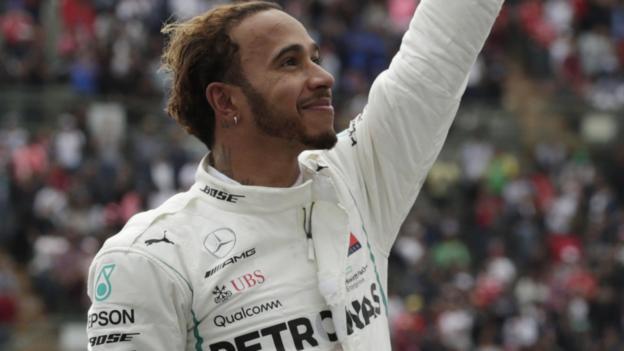104068183 hamilton win reuters - Lewis Hamilton equals Juan Manuel Fangio with fifth F1 title