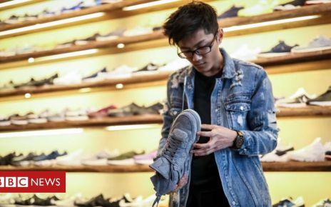107054029 shoe shop - Shoe giants urge Trump to end trade war