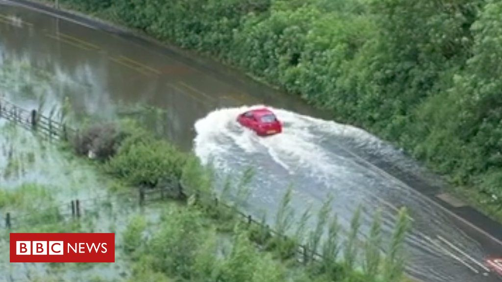 107407444 p07dc7bl - Drone footage captures driver stuck in flood water