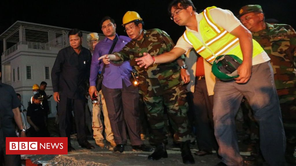 107511339 hi054857066 1 - Cambodia PM Hun Sen visits deadly building collapse site