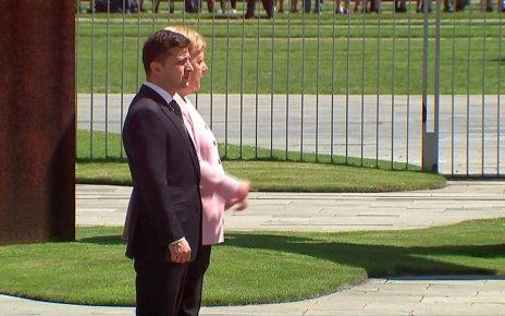 p07dh4m3 - Germany's Angela Merkel 'fine' after seen shaking in heatwave