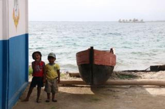 Children and a canoe