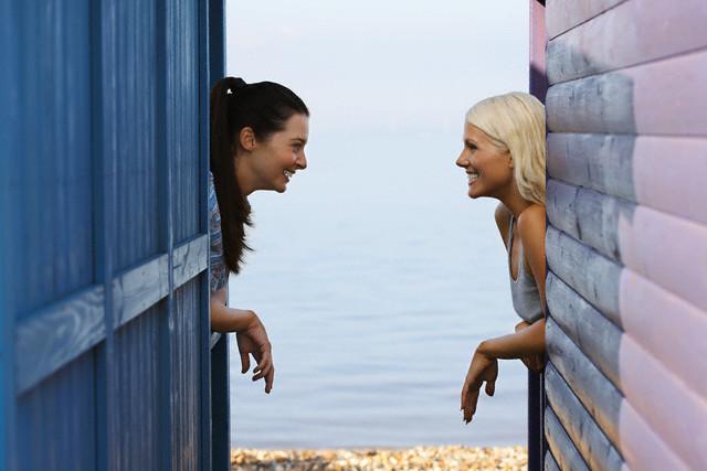Women Talking From Window --- Image by © moodboard/Corbis