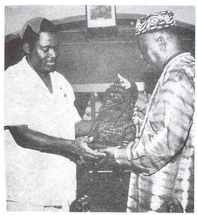 Tarka receives a gift in Benin City