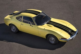 """""""Coke Bottle Shape"""": The design of the Opel GT is reminiscent of the shape of the classic Coca Cola bottle."""