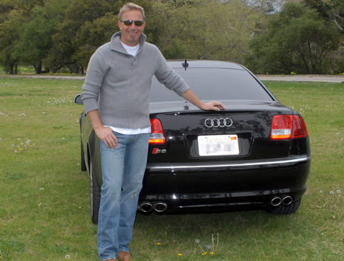 Kevin Costner drives an Audi Q7 and Audi S8.