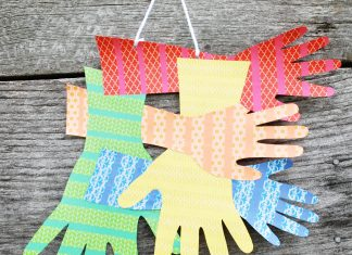 family handprints wall hanging easy kids' craft with construction paper and washi tape