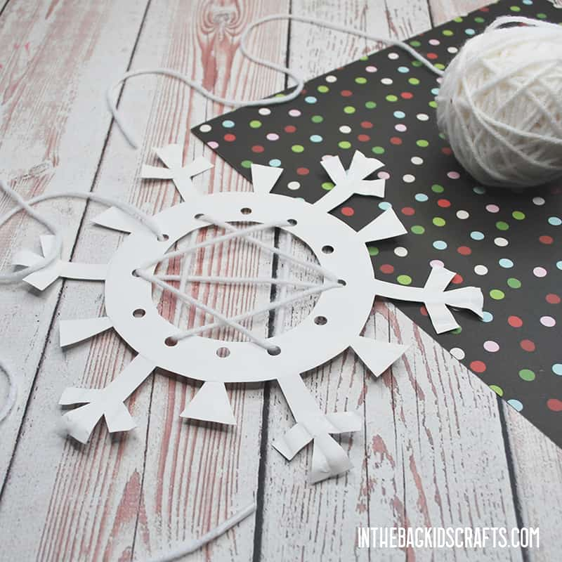 PAPER SNOWFLAKE CRAFTS WITH LACING STEP 3