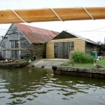 Boat shed on the Thurne with geese
