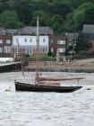 A smack moored opposite the dockyard
