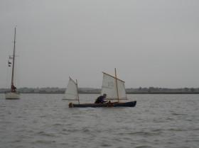 Jim Van Den Bos sailing his yawl-rigged canoe