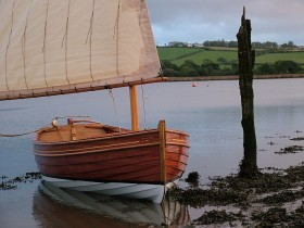 Stirling and Son 14ft dinghy ashore in the mud