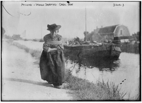 Dutch woman drawing canal boat in Holland