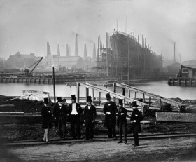 1865: A group of top-hatted 'worthies' in a shipyard. The liner Tancore can be seen in the background. (Photo by Hulton Archive/Getty Images)