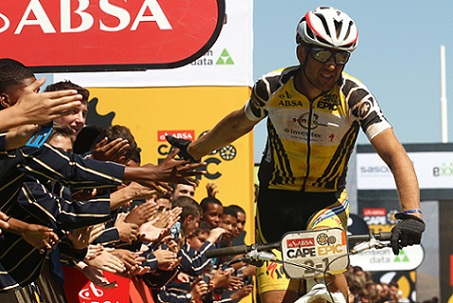 Christoph Sauser of Investec-Songo-Specialized celebrates with the HTS Drostdy school Learners after winning stage 3 with partner Jaroslav Kulhavy of Investec-Songo-Specialized during stage 3 of the 2015 Absa Cape Epic Mountain Bike stage race held from Oak Valley Wine Estate in Elgin to HTS Drostdy in Worcester, South Africa on the 18 March 2015 Photo by Shaun Roy/Cape Epic/SPORTZPICS