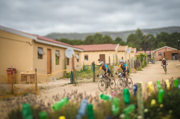 Mountain bikes meandering through the community of Botriver during stage three of the Wines2Whales Ride today. Photo: Tobias Ginsberg