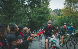Pictured here is a joBerg2c rider being greeted by supporters on route to the finish. Photo: Em Gatland