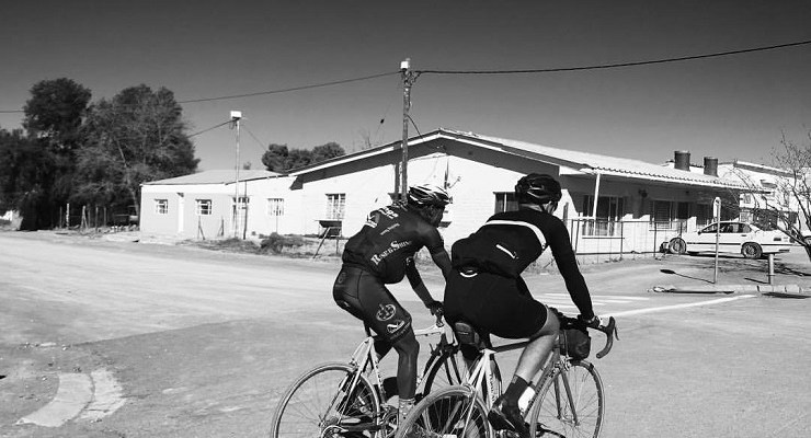 Mpho Moloi and Carsten Schaffer ride to the finish of stage five of the Tour of Ara.