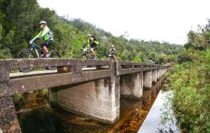 A few riders crossing a bridge on stage one of the Storms River Traverse.