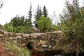 Riders makes their way along a low lying rustic stone bridge during the third day of the Cape Pioneer Trek, which took place in and around George.