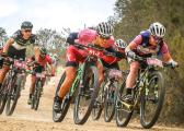 Team Team Spur Valencia's Ariane Luthi (pink) and Amy McDougall lead Dimension Data's Louis Visser in a downhill charge on day three of the Cape Pioneer Trek.