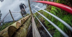 A mountain biker crosses a bridge on day one of the Wines2Whales Race.