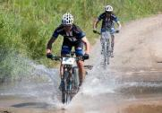Some riders making their way through water during the second stage of the Drak Descent. Photo: Graham Daniel Photography
