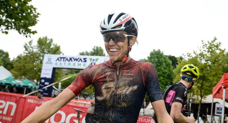 An image of Ariane Lüthi smiling at the 2018 Attakwas Extreme MTB Challenge.