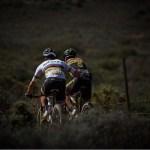 Nino Schurter pictured helping teammate Matthias Stirnemann during stage one of the Cape Epic yesterday. Photo: Gustav Klotz