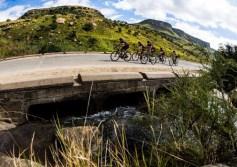Double90 Team Challenge cyclists cross a bridge