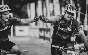 Riders congratulate each other after finishing day three of sani2c Adventure