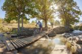 A rider crosses a wooden bridge on day one of sani2c Trail