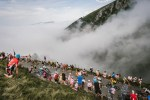Fans cheer as riders pass them during stage 19 of the Tour de France