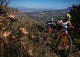 Robyn de Groot (front) pushing her bike up a steep climb on the opening stage of the Wines2Whales Chardonnay. Photo: Greg Beadle