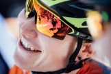A close-up of a female cyclist smiling during the Women's Tour Down Under