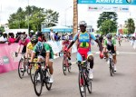 Eritrea's Biniyam Ghirmay pictured winning stage three of the Tropicale Amissa Bongo today, with ProTouch's Rohan du Plooy (right) finishing seventh. Photo: Supplied