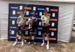 Nolan Hoffman (centre), Ryan Harris (left) and Gustav Basson (right) enjoying the champagne celebrations after the Herald Cycle Tour today. Photo: Twitter/@heraldcycletour