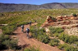 Riders moving around a rock feature at the TransCape MTB Encounter. Photo: Jacques Marais