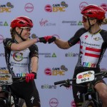 Investec-songo-Specialized's Anna van der Breggen (left) and Annika Langvad fist-bumping each other before the start of their prologue at the Cape Epic yesterday. Photo: Cape Epic