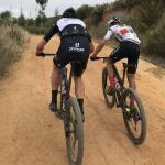 Matt Beers (left) and Alan Hatherly (right) ascending a climb together during the Cape Town Cycle Tour MTB Challenge today. Photo: Twitter/@CTCycleTour