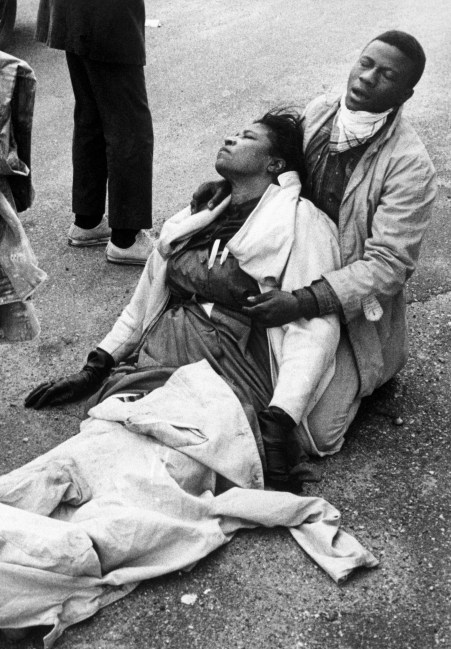 08 Mar 1965, Selma, Alabama, USA --- Amelia Boynton Robinson suffering from exposure to tear gas, holds an unconscious woman after mounted police officers attacked marchers in Selma, Alabama as they were beginning a 50 mile march to Montgomery to protest race discrimination in voter registration. --- Image by © Bettmann/CORBIS