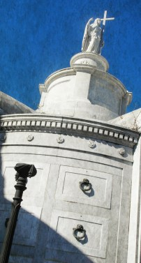 Light and shadow play on a tomb in St Louis Cemetery No. 1 in New Orleans.