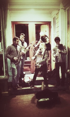 A group of street musicians entertain passers by on Frenchmen Street in New Orleans.