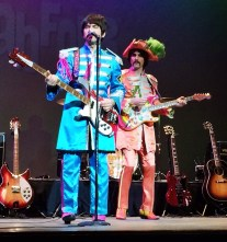 """Paul"" and ""George"" are dressed in full-Sgt. Pepper garb during a Fab Four tribute band concert in Iowa City, Iowa, on March 6, 2015."