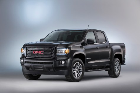 "The 2015 GMC Canyon Nightfall Edition featuring a body-color grille, 18"" aluminum wheels and black body accents, offers customers a stylish package at a great value. © General Motors"