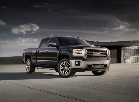 The 2015 GMC Sierra SLT front three quarter view