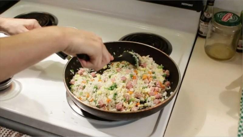 large black skillet full or fried rice.